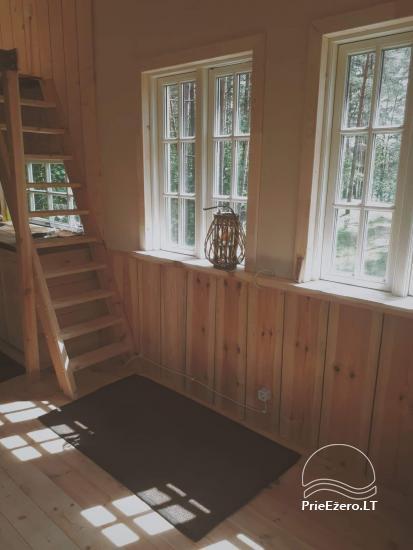 Koka māja ezera krastā Lietuvā - 11
