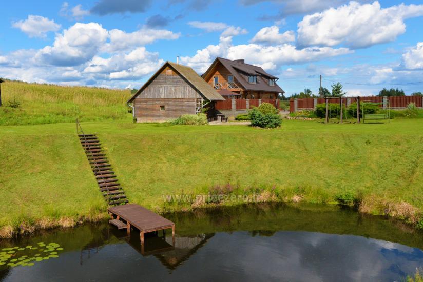 Lauku mājas Romo sodyba uz akmens ezera - 11