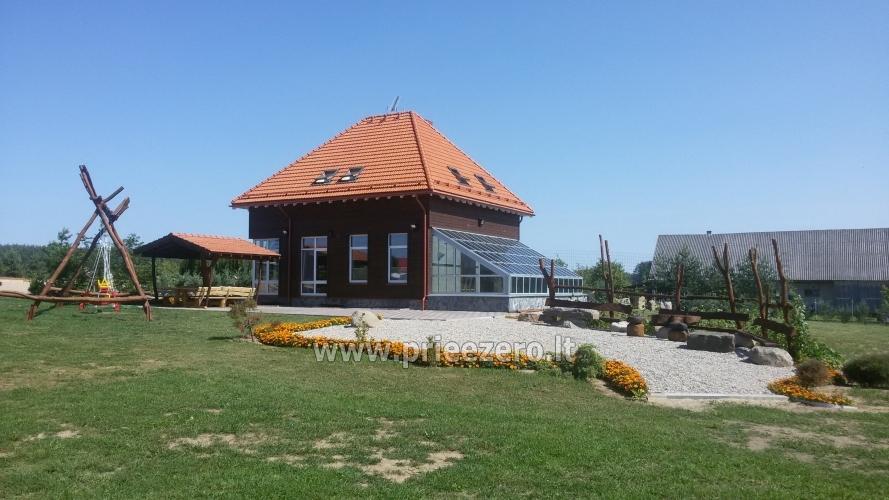 Māja uz ezera krastu: pirts, istabas, banketu zāle 30 personām, kajaki - 9