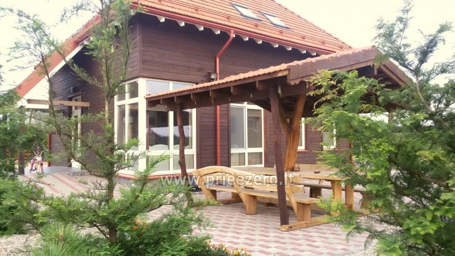 Māja uz ezera krastu: pirts, istabas, banketu zāle 30 personām, kajaki - 11